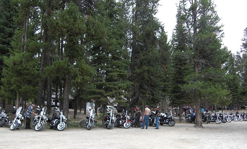 Motorcycles parked near lodge.